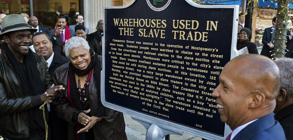 Actor Chris Chalk applauds unveiling of marker about Warehouses Used in the Slave Trade.