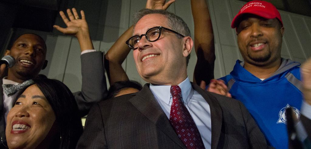 Larry Krasner celebrates Democratic primary win with supporters.