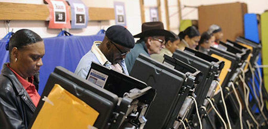 People using voting machines