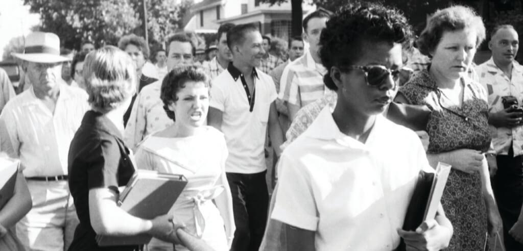 Segregationist protestors surround Elizabeth Eckford as she attempts to integrate Central High School in Little Rock, Arkansas, 1957