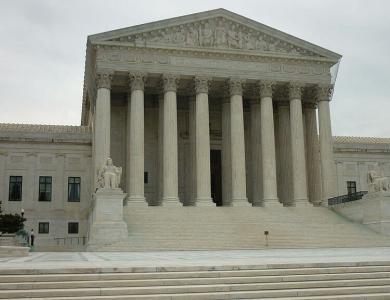 U.S. Supreme Court building with gray sky background.