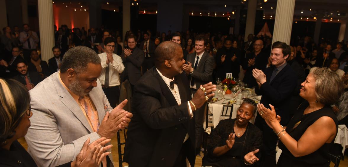 Attendees give Lester Bailey a standing ovation at EJI's benefit dinner