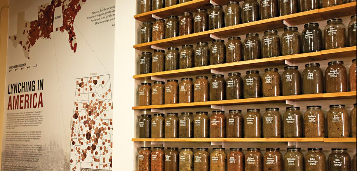 EJI exhibit with shelves containing jars filled with soil from lynching sites