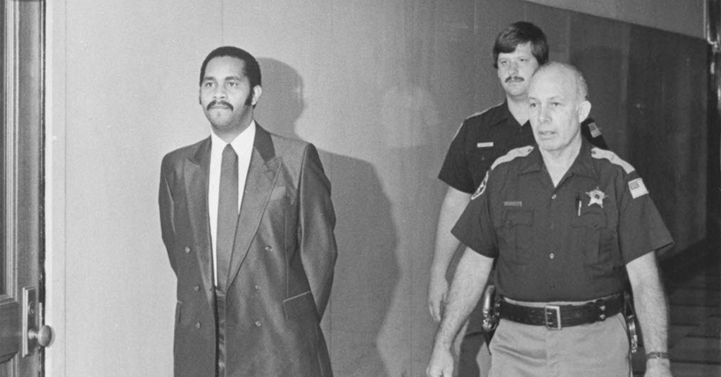 Deputies escort Mr. Hinton in the courthouse during his trial