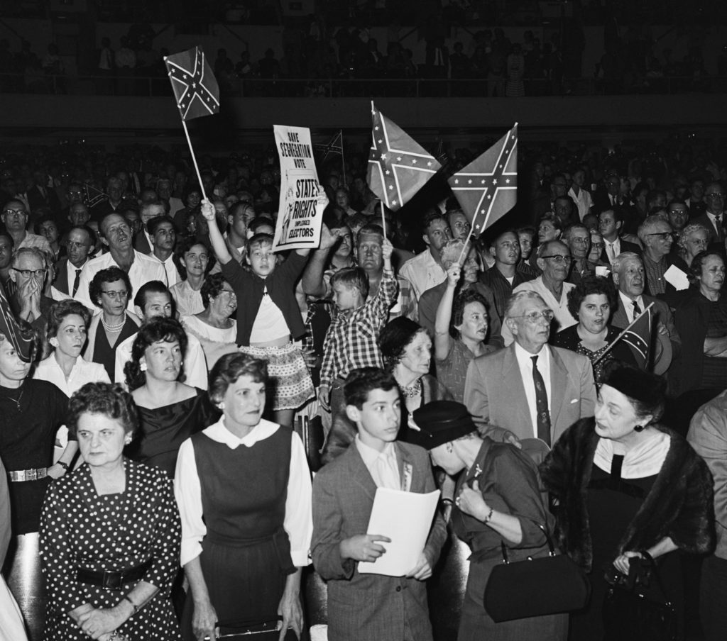 Young children wave Confederate flags at a White Citizens' Council meeting in New Orleans, Louisiana, on November 16, 1960