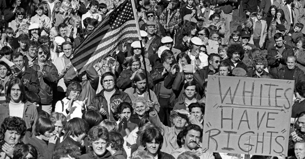 A large crowd gathers in South Boston to protest federal busing orders on September 12, 1974