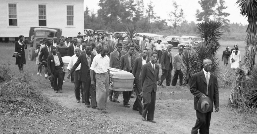 Mourners carry flag-draped coffin of veteran George Dorsey, who was lynched in 1946