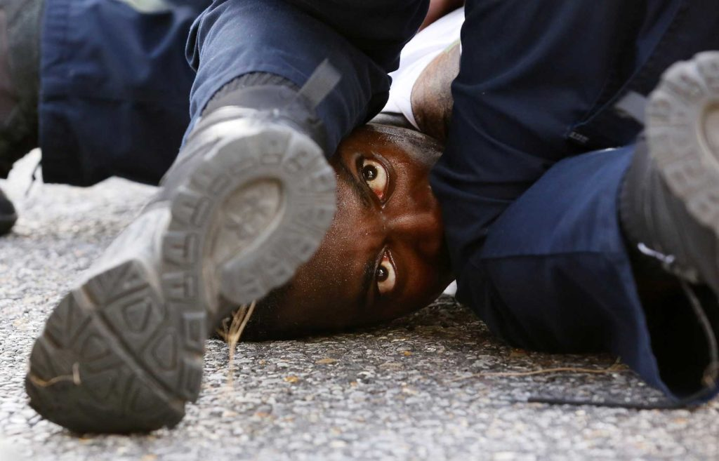 A man is wrestled to the ground by law enforcement in Baton Rouge, Louisiana, while protesting the July 2016 shooting death of Alton Sterling.