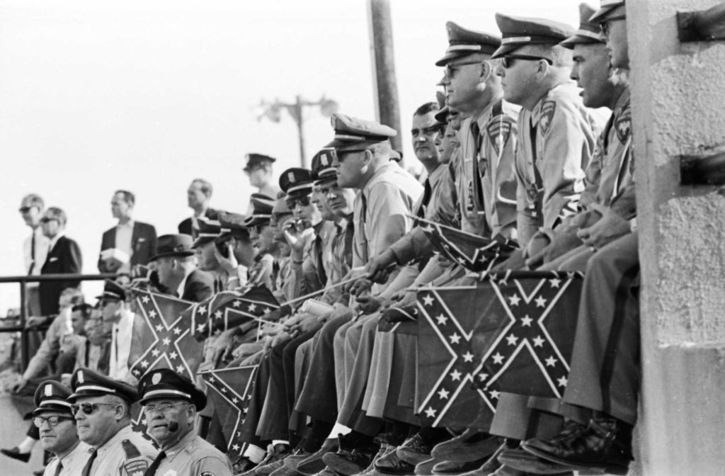 Mississippi Highway Patrolmen watch marchers as they arrive in Montgomery on March 25, 1965