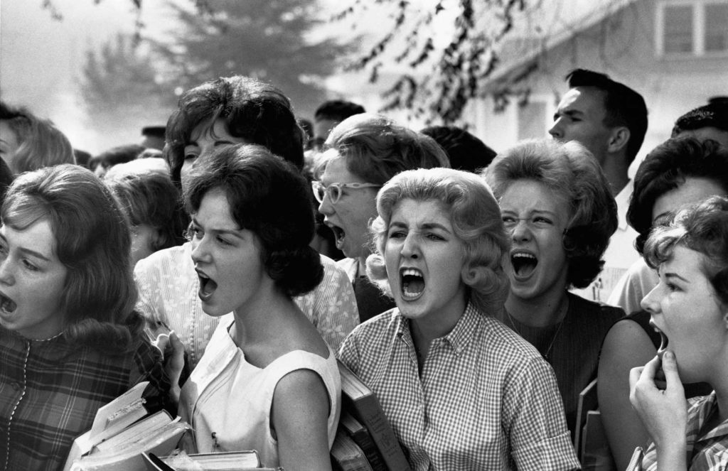 A group of teenage girls scream obscenities at Black students entering their high school in Montgomery, Alabama
