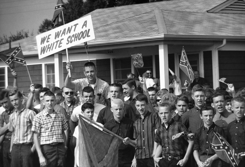 Teenage boys wave Confederate flags during a protest against school integration in Montgomery, Alabama, 1963